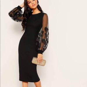 Black bodycon with lace floral sleeves